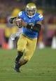 Nov 30, 2013; Los Angeles, CA, USA; UCLA Bruins quarterback Brett Hundley (17) scrambles against the Southern California Trojans at Los Angeles Memorial Coliseum. Mandatory Credit: Kirby Lee-USA TODAY Sports