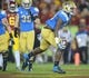 Nov 30, 2013; Los Angeles, CA, USA; UCLA Bruins linebacker Myles Jack (30) celebrates after scoring a touchdown against the Southern California Trojans at Los Angeles Memorial Coliseum. Mandatory Credit: Kirby Lee-USA TODAY Sports