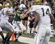 Nov 30, 2013; Honolulu, HI, USA; Hawaii Warriors quarterback Sean Schroeder (19) scores a touchdown against the Army Black Knights during the fourth quarter at Aloha Stadium. Mandatory Credit: Marco Garcia-USA TODAY Sports