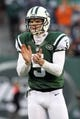 Dec 1, 2013; East Rutherford, NJ, USA; New York Jets quarterback Matt Simms (5) claps during the fourth quarter of a game against the Miami Dolphins at MetLife Stadium. The Dolphins defeated the Jets 23-3. Mandatory Credit: Brad Penner-USA TODAY Sports