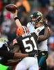 Dec 1, 2013; Cleveland, OH, USA; Jacksonville Jaguars quarterback Chad Henne (7) throws a pass while being pressured by Cleveland Browns outside linebacker Barkevious Mingo (51) in the fourth quarter at FirstEnergy Stadium. Mandatory Credit: Andrew Weber-USA TODAY Sports