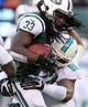 Dec 1, 2013; East Rutherford, NJ, USA; New York Jets running back Chris Ivory (33) is tackled by Miami Dolphins defensive tackle Paul Soliai (96) during the third quarter of a game at MetLife Stadium. The Dolphins defeated the Jets 23-3. Mandatory Credit: Brad Penner-USA TODAY Sports
