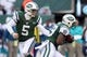 Dec 1, 2013; East Rutherford, NJ, USA; New York Jets quarterback Matt Simms (5) hands off to running back Bilal Powell (29) against the Miami Dolphins during the third quarter of a game at MetLife Stadium. The Dolphins defeated the Jets 23-3. Mandatory Credit: Brad Penner-USA TODAY Sports
