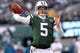 Dec 1, 2013; East Rutherford, NJ, USA; New York Jets quarterback Matt Simms (5) throws a pass against the Miami Dolphins during the third quarter of a game at MetLife Stadium. The Dolphins defeated the Jets 23-3. Mandatory Credit: Brad Penner-USA TODAY Sports