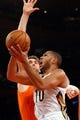Dec 1, 2013; New York, NY, USA;  New York Knicks power forward Andrea Bargnani (77) fouls New Orleans Pelicans shooting guard Eric Gordon (10) at the net during the third quarter at Madison Square Garden. New Orleans Pelicans won 103-99.  Mandatory Credit: Anthony Gruppuso-USA TODAY Sports