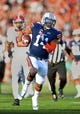 Nov 30, 2013; Auburn, AL, USA;  Auburn Tigers quarterback Nick Marshall (14) carries the ball for a 45 yard touchdown in the first quarter against the Alabama Crimson Tide at Jordan Hare Stadium. Mandatory Credit: RVR Photos-USA TODAY Sports