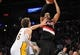 December 1, 2013; Los Angeles, CA, USA; Portland Trail Blazers power forward LaMarcus Aldridge (12) shoots a basket against the defense of Los Angeles Lakers center Pau Gasol (16) during the first half at Staples Center. Mandatory Credit: Gary A. Vasquez-USA TODAY Sports