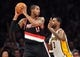 December 1, 2013; Los Angeles, CA, USA; Portland Trail Blazers power forward LaMarcus Aldridge (12) controls the ball against the Los Angeles Lakers during the second half at Staples Center. Mandatory Credit: Gary A. Vasquez-USA TODAY Sports