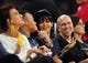 December 1, 2013; Los Angeles, CA, USA; Recording artist Rihanna with film executive Jeffrey Katzenberg in attendance  as the Los Angeles Lakers play against the Portland Trail Blazers during the second half at Staples Center. Mandatory Credit: Gary A. Vasquez-USA TODAY Sports