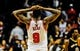 Dec 2, 2013; Chicago, IL, USA; Chicago Bulls small forward Luol Deng (9) reacts at the end of the third overtime of their game against the New Orleans Pelicans at the United Center. The Pelicans won 131-126.  Mandatory Credit: Matt Marton-USA TODAY Sports