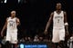 Nov 27, 2013; Brooklyn, NY, USA; Brooklyn Nets small forward Paul Pierce (34) and power forward Kevin Garnett (2) looks on against the Los Angeles Lakers at Barclays Center. The Lakers won 99-94. Mandatory Credit: Joe Camporeale-USA TODAY Sports