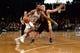 Nov 27, 2013; Brooklyn, NY, USA; Los Angeles Lakers point guard Steve Blake (5) guards Brooklyn Nets shooting guard Alan Anderson (6) at Barclays Center. The Lakers won 99-94. Mandatory Credit: Joe Camporeale-USA TODAY Sports
