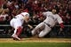 Oct 28, 2013; St. Louis, MO, USA; Boston Red Sox catcher David Ross (right) is tagged out at home plate by St. Louis Cardinals catcher Yadier Molina (left) in the 7th inning during game five of the MLB baseball World Series at Busch Stadium. Mandatory Credit: Scott Rovak-USA TODAY Sports