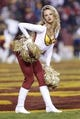 Dec 1, 2013; Landover, MD, USA; A Washington Redskins cheerleader dances on the field during a stoppage in play against the New York Giants in the third quarter at FedEx Field. The Giants won 24-17. Mandatory Credit: Geoff Burke-USA TODAY Sports