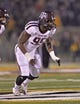 Nov 30, 2013; Columbia, MO, USA; Texas A&M Aggies defensive linemen Julien Obioha (95) gets set on defense against the Missouri Tigers during the first half at Faurot Field. Mandatory Credit: Peter G. Aiken-USA TODAY Sports