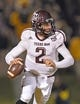 Nov 30, 2013; Columbia, MO, USA; Texas A&M Aggies quarterback Johnny Manziel (2) rolls out against the Missouri Tigers during the first half at Faurot Field. Mandatory Credit: Peter G. Aiken-USA TODAY Sports