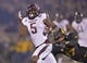 Nov 30, 2013; Columbia, MO, USA; Texas A&M Aggies running back Brandon Williams (5) rushes up field past Missouri Tigers safety Matt White (17) during the first half at Faurot Field. Mandatory Credit: Peter G. Aiken-USA TODAY Sports