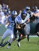 Nov 30, 2013; Chapel Hill, NC, USA;  Duke Blue Devils tight end Braxton Deaver (89) with the ball as North Carolina Tar Heels defensive back Justin St. Onge (34) defends in the first quarter at Kenan Memorial Stadium. Mandatory Credit: Bob Donnan-USA TODAY Sports