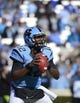 Nov 30, 2013; Chapel Hill, NC, USA; North Carolina Tar Heels quarterback Marquise Williams (12) looks to pass in the first quarter at Kenan Memorial Stadium. Mandatory Credit: Bob Donnan-USA TODAY Sports