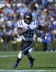 Nov 30, 2013; Chapel Hill, NC, USA; Duke Blue Devils running back Jela Duncan (25) runs in the second quarter at Kenan Memorial Stadium. Mandatory Credit: Bob Donnan-USA TODAY Sports