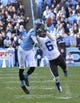 Nov 30, 2013; Chapel Hill, NC, USA;  Duke Blue Devils cornerback Ross Cockrell (6) tries to intercept the ball as North Carolina Tar Heels wide receiver Quinshad Davis (14) looks on. The Duke Blue Devils defeated the North Carolina Tar Heels 27-25 at Kenan Memorial Stadium. Mandatory Credit: Bob Donnan-USA TODAY Sports