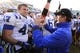 Nov 30, 2013; Chapel Hill, NC, USA;  Duke Blue Devils head coach David Cutcliff with linebacker David Helton (47) after the game. The Duke Blue Devils defeated the North Carolina Tar Heels 27-25 at Kenan Memorial Stadium. Mandatory Credit: Bob Donnan-USA TODAY Sports