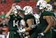 Nov 16, 2013; Tampa, FL, USA; South Florida Bulls quarterback Mike White (14) huddles up with teammates against the Memphis Tigers during the second quarter at Raymond James Stadium. Mandatory Credit: Kim Klement-USA TODAY Sports