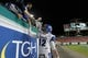 Nov 16, 2013; Tampa, FL, USA; Memphis Tigers quarterback Paxton Lynch (12) high five fans after they beat the South Florida Bulls at Raymond James Stadium. Memphis Tigers defeated the South Florida Bulls 23-10. Mandatory Credit: Kim Klement-USA TODAY Sports