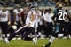 Dec 5, 2013; Jacksonville, FL, USA; Houston Texans quarterback Matt Schaub (8) slides for a seven-yard gain as he is pursued by Jacksonville Jaguars cornerback Mike Harris (20) in the fourth quarter at EverBank Field. The Jacksonville Jaguars best the Houston Texans 27-20. Mandatory Credit: Phil Sears-USA TODAY Sports
