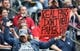 Dec 1, 2013; Houston, TX, USA; Houston Texans fan holds up a sign against wearing paper bags during the game against the New England Patriots at Reliant Stadium. Mandatory Credit: Matthew Emmons-USA TODAY Sports