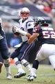 Dec 1, 2013; Houston, TX, USA; New England Patriots quarterback Tom Brady (12) is blitzed in the pocket by Houston Texans linebacker Jeff Tarpinian (52) at Reliant Stadium. Mandatory Credit: Matthew Emmons-USA TODAY Sports