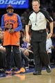 Dec 6, 2013; New York, NY, USA; Actor and director Spike Lee jokes with an official during the second half of the Orlando Magic and New York Knicks game at Madison Square Garden. The Knicks won the game 121-83. Mandatory Credit: Joe Camporeale-USA TODAY Sports