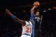 Dec 6, 2013; New York, NY, USA; Orlando Magic shooting guard Arron Afflalo (4) puts up a shot over New York Knicks shooting guard Iman Shumpert (21) during the first half at Madison Square Garden. The Knicks won the game 121-83. Mandatory Credit: Joe Camporeale-USA TODAY Sports