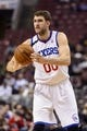 Dec 3, 2013; Philadelphia, PA, USA; Philadelphia 76ers center Spencer Hawes (00) passes the ball during the fourth quarter against the Orlando Magic at the Wells Fargo Center. The Sixers defeated the Magic 126-125 in double overtime. Mandatory Credit: Howard Smith-USA TODAY Sports