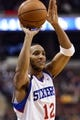 Dec 3, 2013; Philadelphia, PA, USA; Philadelphia 76ers guard Evan Turner (12) passes the ball during the fourth quarter against the Orlando Magic at the Wells Fargo Center. The Sixers defeated the Magic 126-125 in double overtime. Mandatory Credit: Howard Smith-USA TODAY Sports