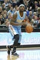 Nov 27, 2013; Minneapolis, MN, USA; Denver Nuggets guard Ty Lawson (3) against the Minnesota Timberwolves at Target Center. The Nuggets defeated the Timberwolves 117-110. Mandatory Credit: Brace Hemmelgarn-USA TODAY Sports