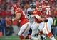 Dec 1, 2013; Kansas City, MO, USA; Kansas City Chiefs quarterback Alex Smith (11) hands off the ball during the first half of the game against the Denver Broncos at Arrowhead Stadium. Denver won 35-28. Mandatory Credit: Denny Medley-USA TODAY Sports