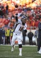 Dec 1, 2013; Kansas City, MO, USA; Denver Broncos quarterback Peyton Manning (18) warms up before the game against the Kansas City Chiefs at Arrowhead Stadium. Denver won the game 35-28. Mandatory Credit: John Rieger-USA TODAY Sports