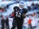 Nov 29, 2013; Buffalo, NY, USA; Buffalo Bulls running back Branden Oliver (32) runs the ball against the Bowling Green Falcons at Ralph Wilson Stadium. Mandatory Credit: Timothy T. Ludwig-USA TODAY Sports