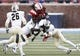Dec 7, 2013; Dallas, TX, USA; Southern Methodist Mustangs wide receiver Darius Joseph (18) is tackled after a catch by UCF Knights linebacker Terrance Plummer (41) and defensive back Sean Maag (31) during the second half of an NCAA football game at Gerald J. Ford Stadium. UCF Knights won 17-13. Mandatory Credit: Jim Cowsert-USA TODAY Sports