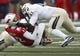 Dec 7, 2013; Dallas, TX, USA; Southern Methodist Mustangs quarterback Neal Burcham (12) is tackled by UCF Knights linebacker Terrance Plummer (41) during the second half of an NCAA football game at Gerald J. Ford Stadium. Southern Methodist Mustangs Neal Burcham was injured and left the game on the play. UCF Knights won 17-13. Mandatory Credit: Jim Cowsert-USA TODAY Sports