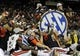 Dec 7, 2013; Atlanta, GA, USA; The Auburn Tigers celebrate with the trophy after defeating the Missouri Tigers in the 2013 SEC Championship game at Georgia Dome. Auburn won 59-42. Mandatory Credit: John David Mercer-USA TODAY Sports
