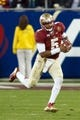Dec 7, 2013; Charlotte, NC, USA; Florida State Seminoles quarterback Jameis Winston (5) runs the ball during the third quarter against the Duke Blue Devils at Bank of America Stadium. FSU defeated Duke 45-7. Mandatory Credit: Jeremy Brevard-USA TODAY Sports