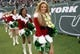 Dec 8, 2013; East Rutherford, NJ, USA; New York Jets cheerleaders perform in Christmas costumes during the game against the Oakland Raiders at MetLife Stadium. Mandatory Credit: Kirby Lee-USA TODAY Sports