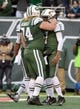 Dec 8, 2013; East Rutherford, NJ, USA; New York Jets quarterback Geno Smith (7) celebrates with center Nick Mangold (74) after scoring on an 8-yard touchdown run against the Oakland Raiders at MetLife Stadium. The Jets defeated the Raiders 37-27 Mandatory Credit: Kirby Lee-USA TODAY Sports