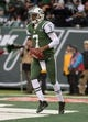 Dec 8, 2013; East Rutherford, NJ, USA; New York Jets quarterback Geno Smith (7) celebrates after scoring on an 8-yard touchdown run against the Oakland Raiders at MetLife Stadium. The Jets defeated the Raiders 37-27 Mandatory Credit: Kirby Lee-USA TODAY Sports