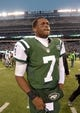 Dec 8, 2013; East Rutherford, NJ, USA; New York Jets quarterback Geno Smith (7) walks off the field after the game against the Oakland Raiders at MetLife Stadium. The Jets defeated the Raiders 37-27 Mandatory Credit: Kirby Lee-USA TODAY Sports