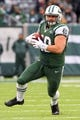 Dec 8, 2013; East Rutherford, NJ, USA; New York Jets fullback Tommy Bohanon (40) runs with the ball after catching a pass during the second half at MetLife Stadium. The Jets defeated the Raiders 37-27.  Mandatory Credit: Ed Mulholland-USA TODAY Sports