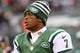 Dec 8, 2013; East Rutherford, NJ, USA; New York Jets quarterback Geno Smith (7) watches the action during the second half at MetLife Stadium. The Jets defeated the Raiders 37-27.  Mandatory Credit: Ed Mulholland-USA TODAY Sports