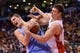 Dec 1, 2013; Toronto, Ontario, CAN; Denver Nuggets center Timofey Mozgov (25) and Toronto Raptors power forward Tyler Hansbrough (50) wrestle for a rebound during the fourth quarter of a game at the Air Canada Centre. Denver won the game 112-98. Mandatory Credit: Mark Konezny-USA TODAY Sports